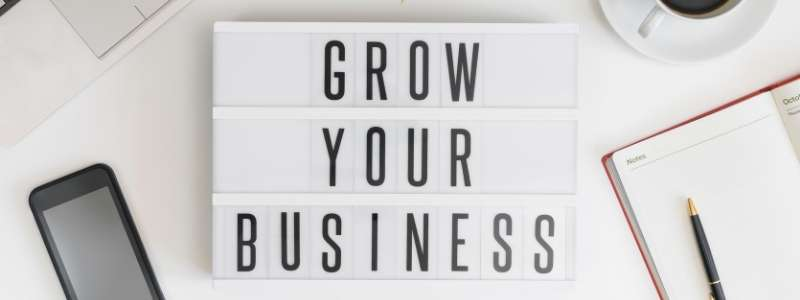 A sign that says how to grow your business with SEO in mind
